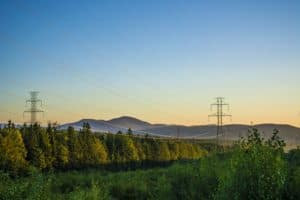 high voltage power lines running through beautiful landscape