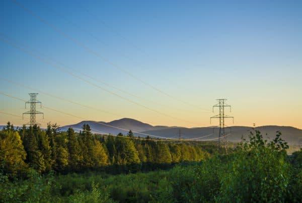 high voltage power lines running through beautiful landscape