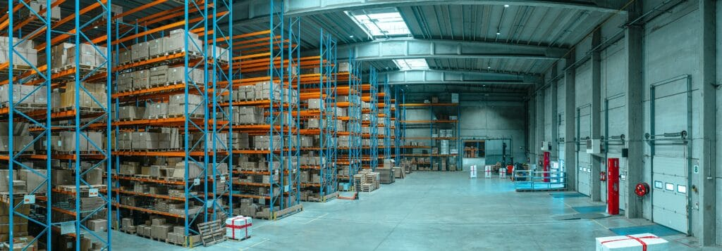 supply chain warehouse with shelves of boxes